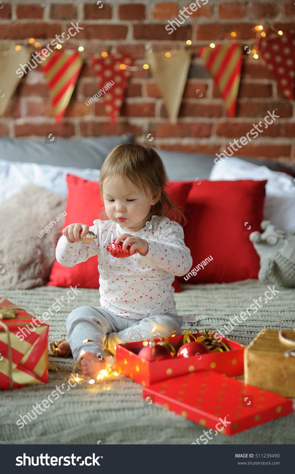 Royalty-free Christmas. Small child sits on a bed.… #511239490 Stock ...