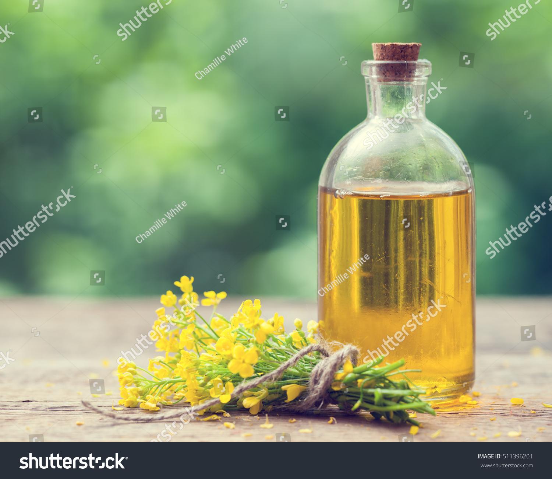 bottle rapeseed oil canola rape flowers stock photo. Black Bedroom Furniture Sets. Home Design Ideas