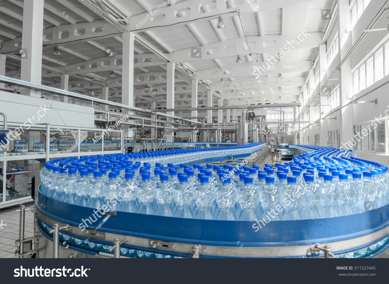 Production Plastic Bottles Bottles On Conveyor Stock Photo