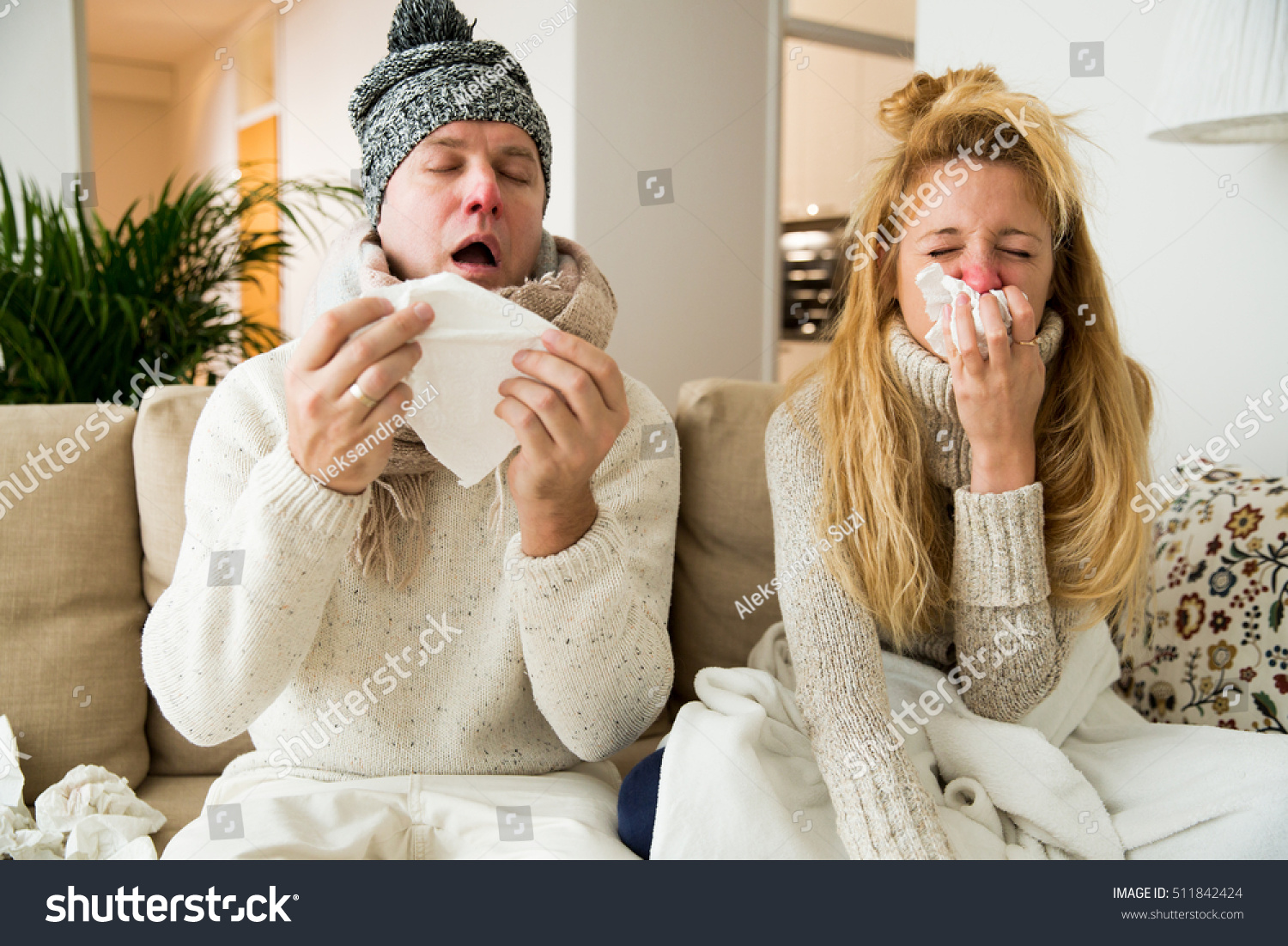 Sick couple catch cold. Man and woman sneezing, coughing. People got flu, having runny nose.  #511842424