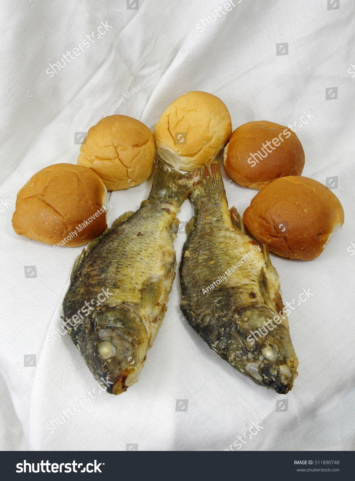 Took five loaves two fishes stock photo 511890748 for Five loaves two fish