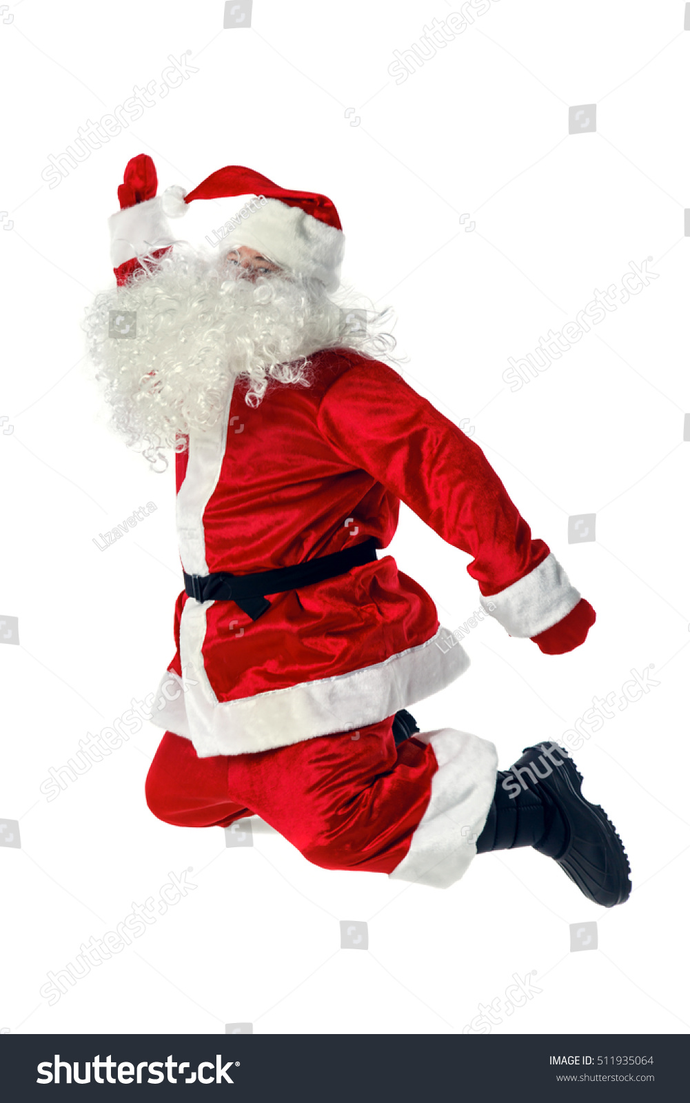 Joyful santa claus jumping stock photo