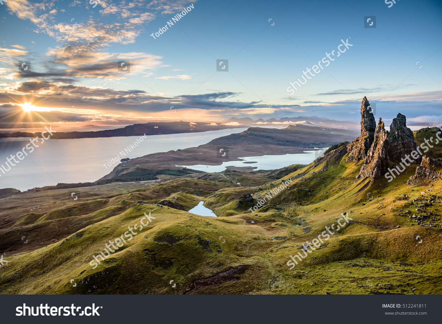 Sunrise Old Man Storr Beautiful Panorama Stock Photo - This man hikes up the transylvanian mountains every morning to photograph sunrise