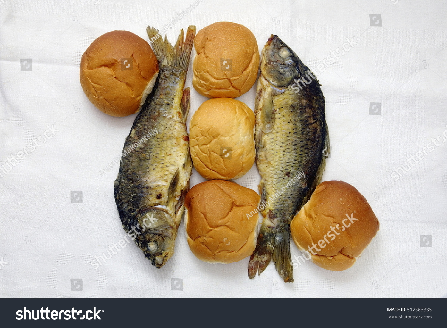 Five loaves two fishes stock photo 512363338 shutterstock for Five loaves two fish