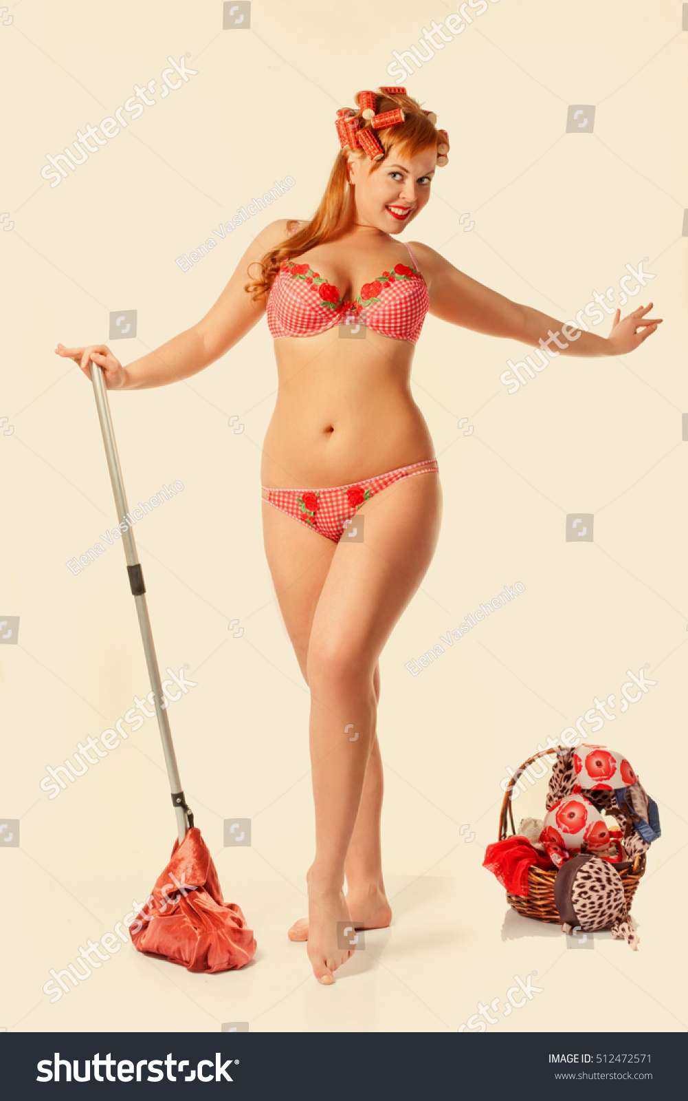 Attractive pin-up girl wearing underwear posing with swab. Toning photo for  vintage effect