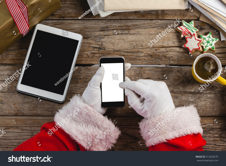 Hand Santa Claus Using Mobile Phone Stock Photo 512639275 ...