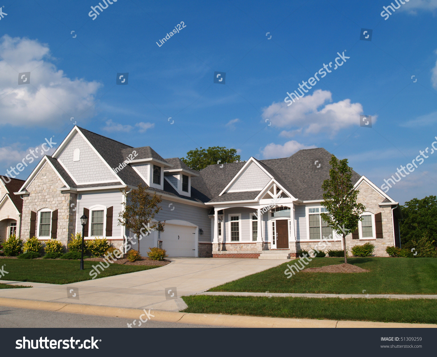 one story vinyl stone residential home stock photo 51309259 one story vinyl and stone residential home with garage in front containing plenty of copy space