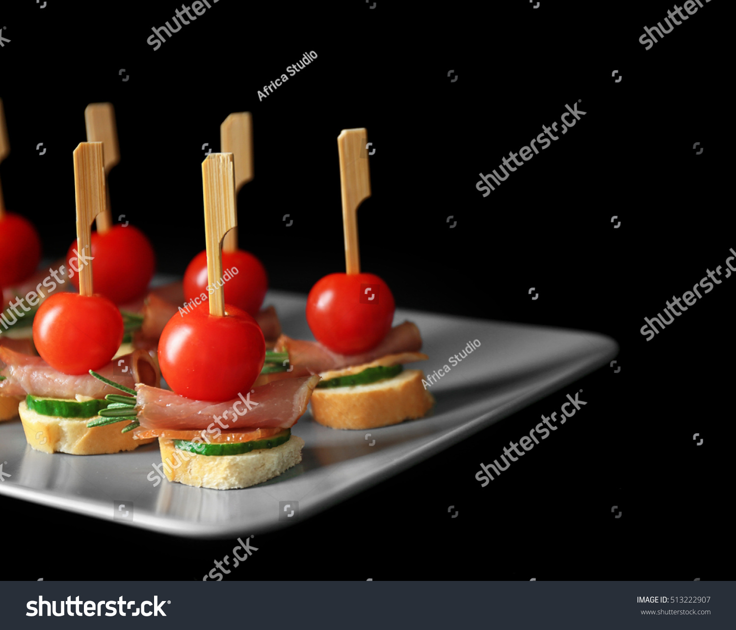 Plate set delicious canapes on black stock photo 513222907 for Canape bread mold set