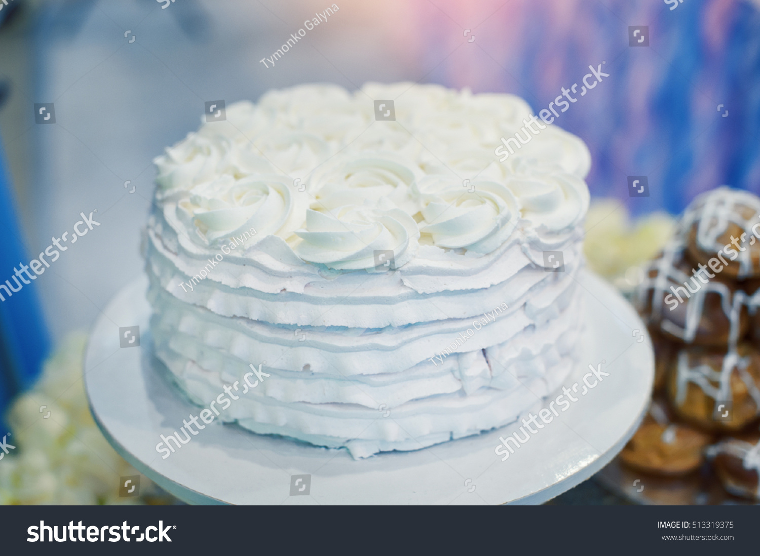 Beautiful white wedding cake flowers on stock photo 513319375 beautiful white wedding cake with flowers on a table izmirmasajfo Images