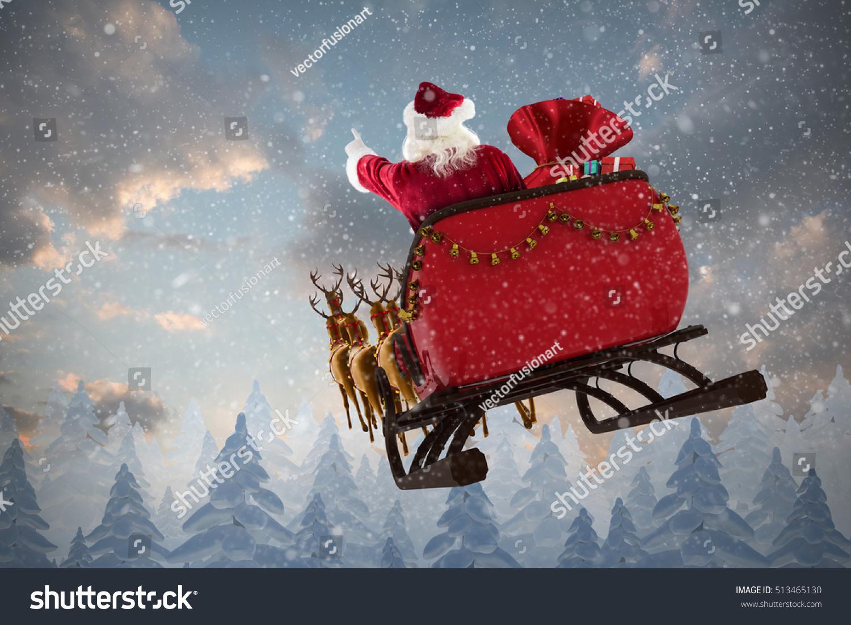 santa claus riding on sled gift stock photo 513465130