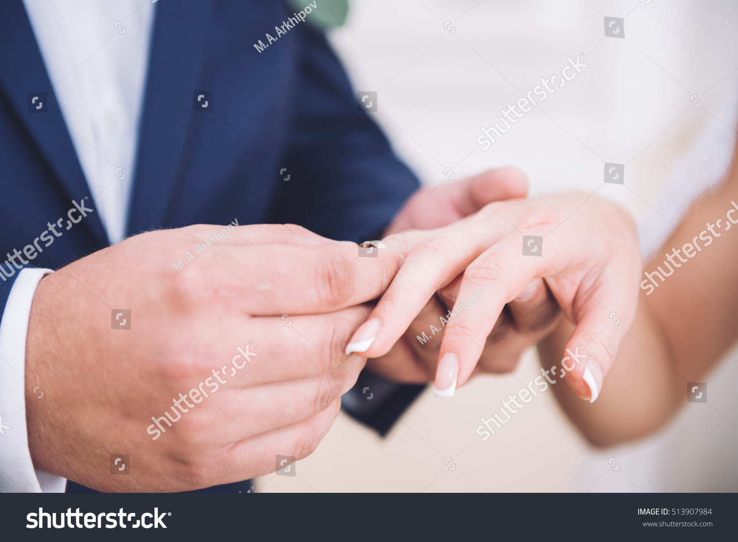 Bride and groom with wedding rings | EZ Canvas
