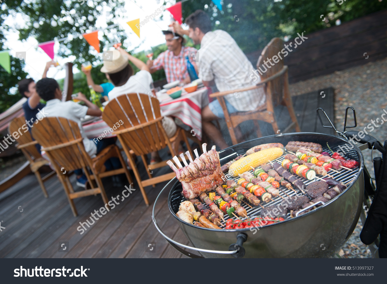 family having barbecue party their garden stock photo 513997327 shutterstock. Black Bedroom Furniture Sets. Home Design Ideas