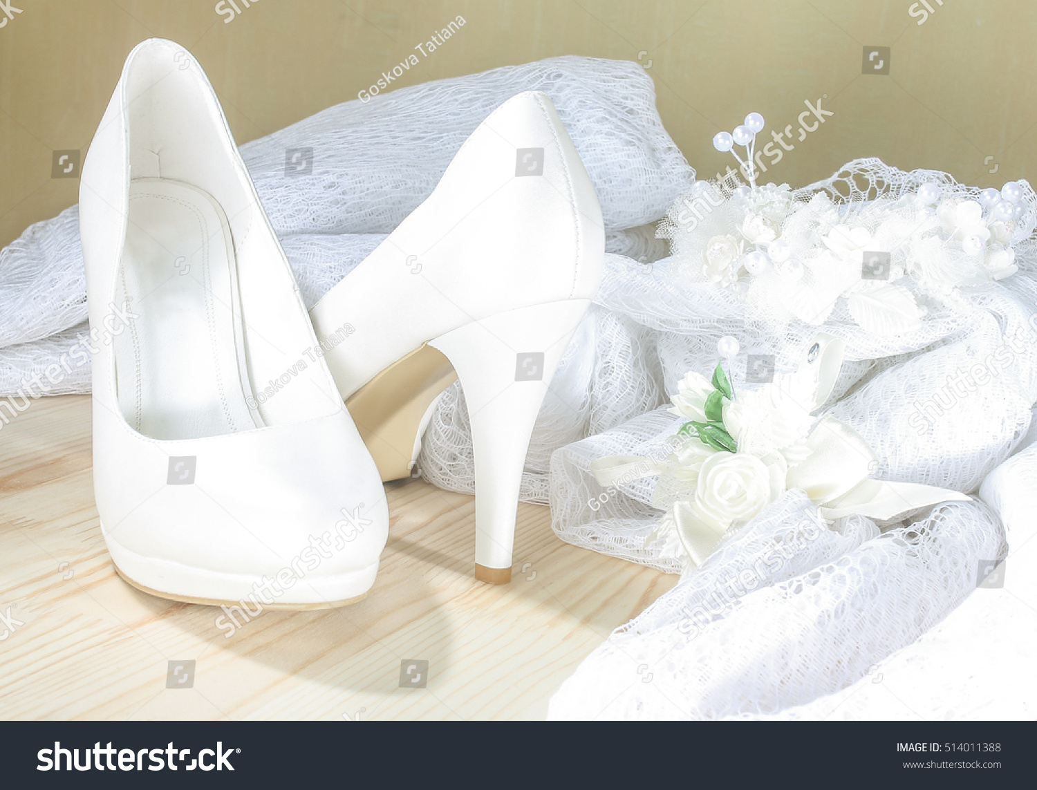 White bridal wedding shoes next decorative stock photo edit now white bridal wedding shoes next to decorative lace junglespirit Image collections