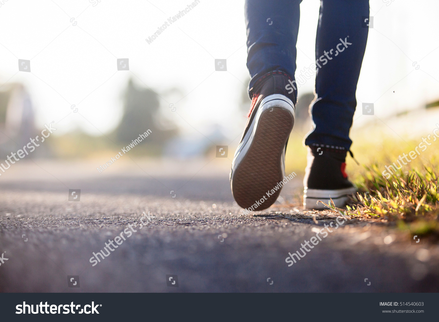 Close Up Of Girl Shoes Walking Stock Photo 514540603
