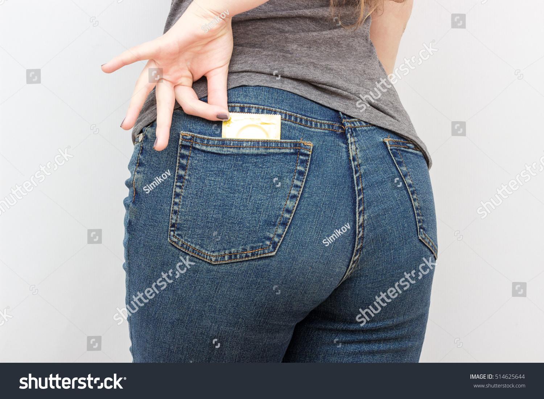 hot woman putting condom on boyfriend
