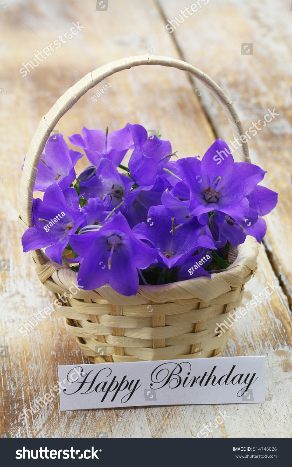Happy birthday card wicker basket filled stock photo 514748026 happy birthday card with wicker basket filled with purple campanula bell flowers on rustic wooden surface dhlflorist Gallery