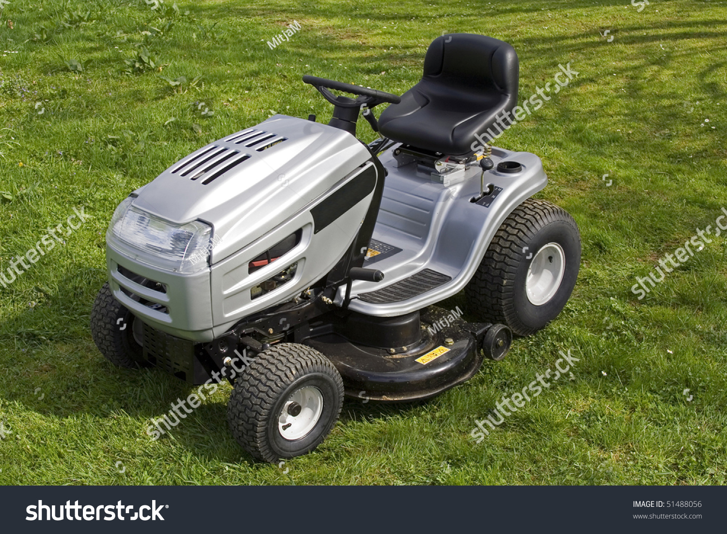 small tractor cutting grass all logos stock photo  small tractor for cutting grass all logos removed warning signs left