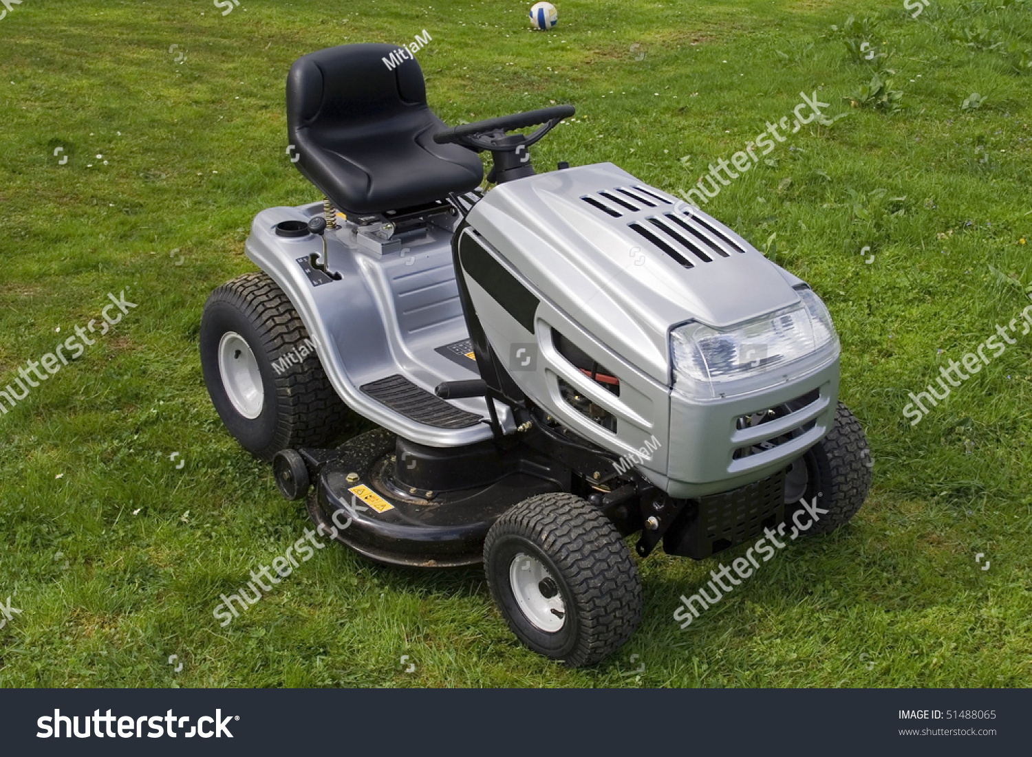 small tractor for cutting grass all logos removed warning signs save to a lightbox