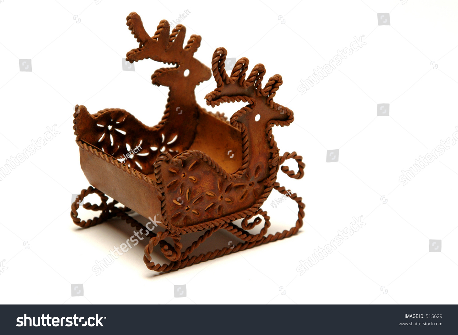 a unique beautiful old christmas ornament of sled pulled