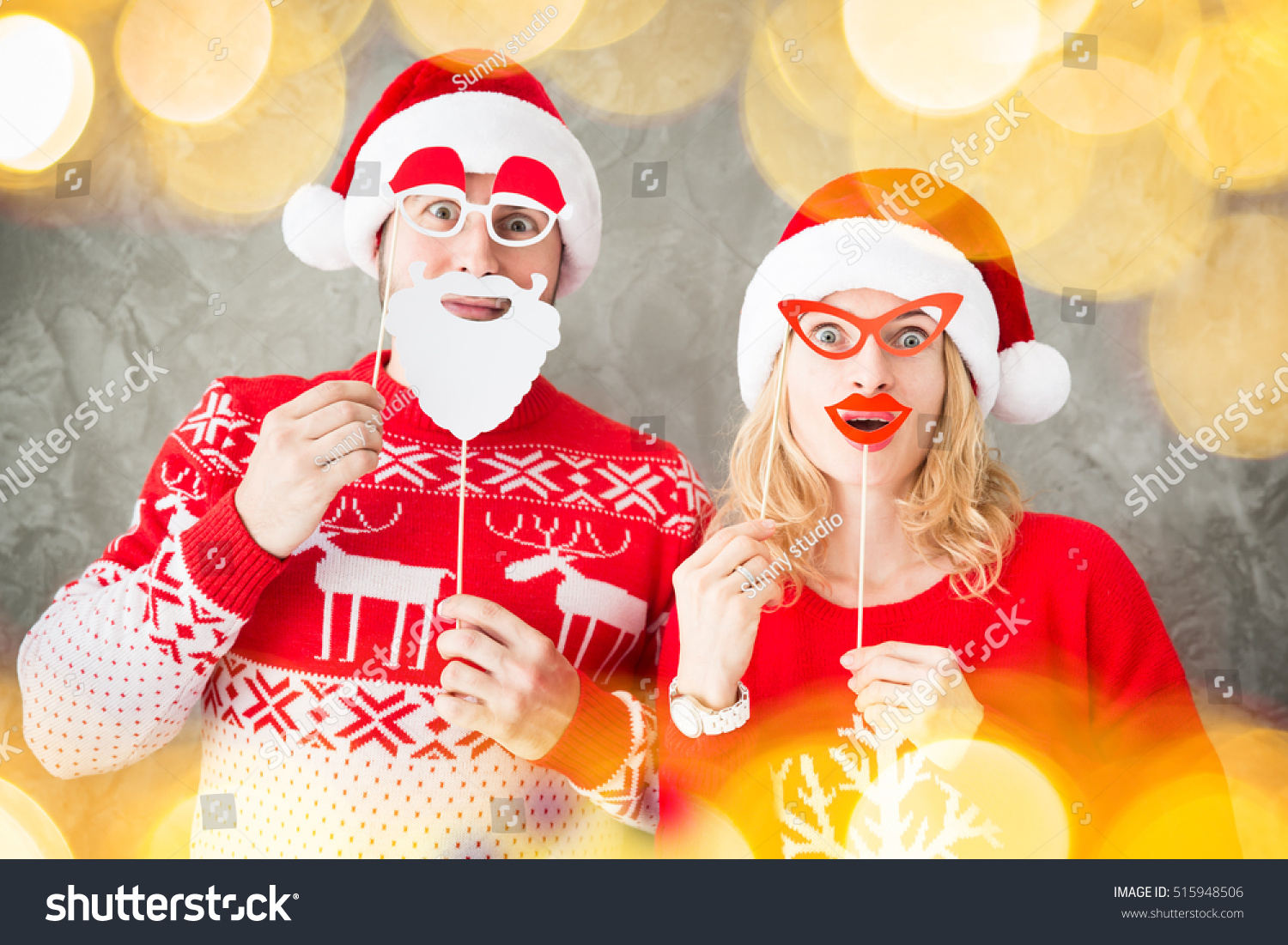 Portrait Of Funny Couple With Christmas Paper Props Man And Woman Having Fun Together