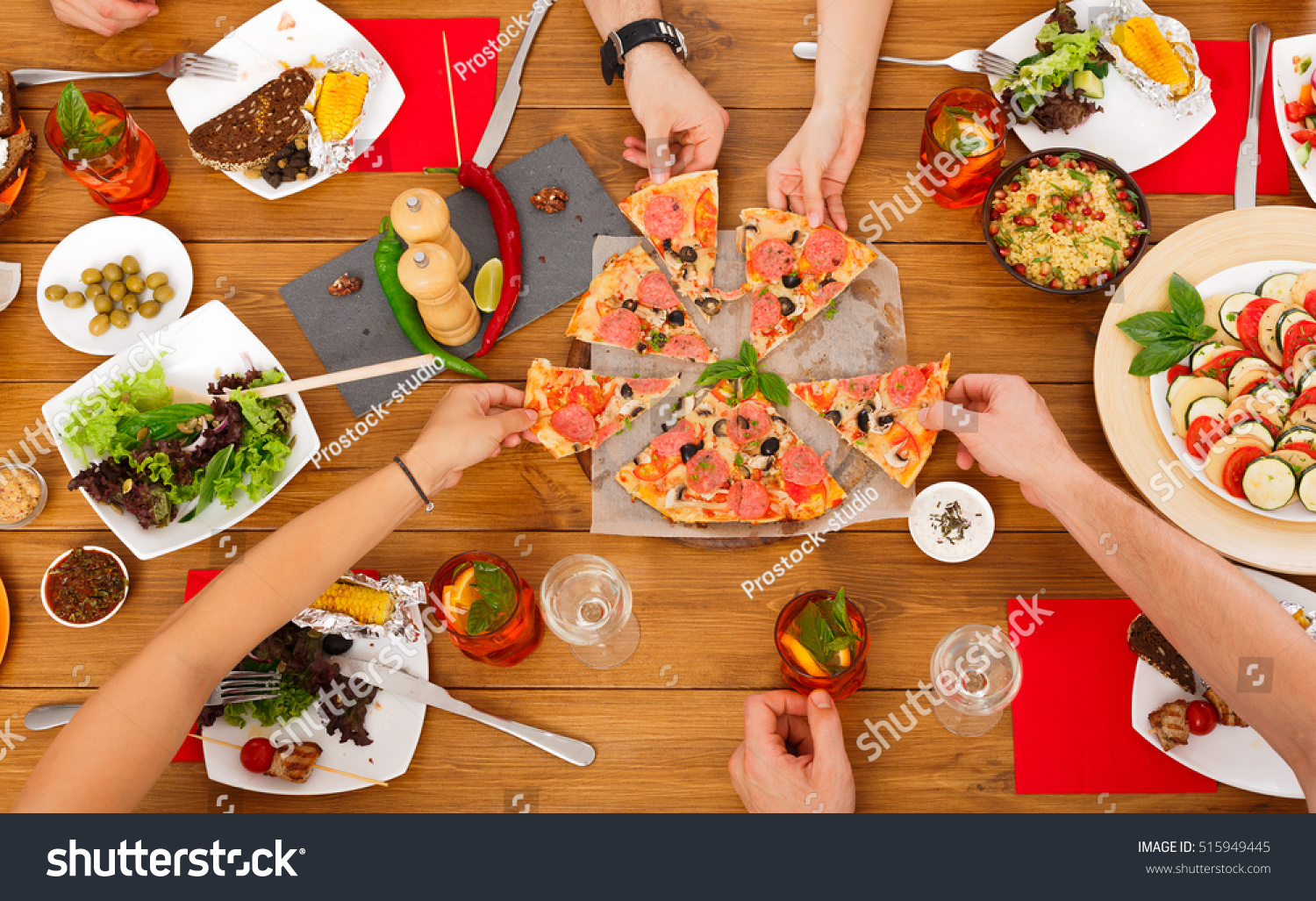 People eat pizza festive table served 515949445 shutterstock - Food network ricette a tavola con guy ...