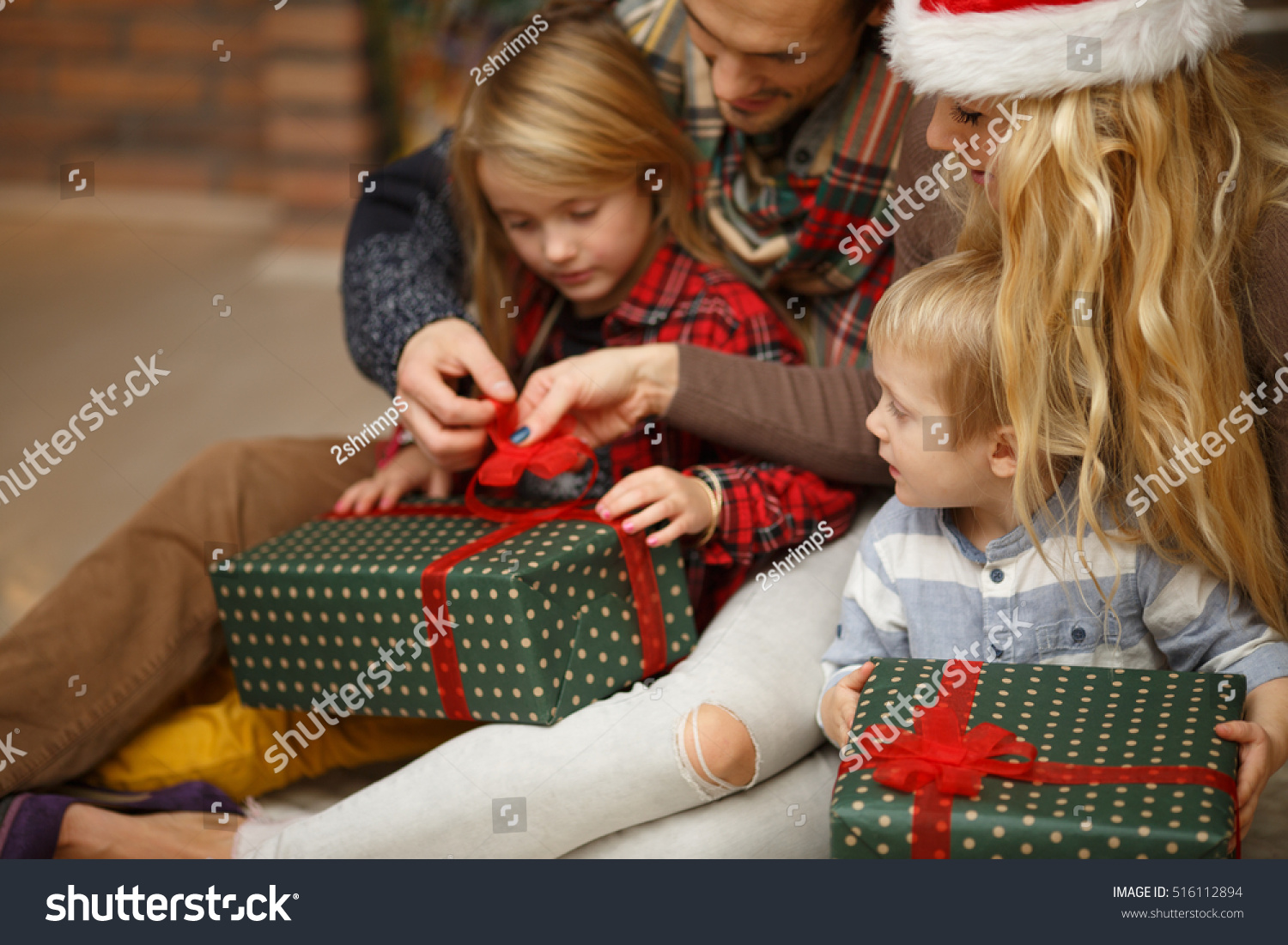 Cheerful Children Open Christmas Gifts Stock Photo (Edit Now ...