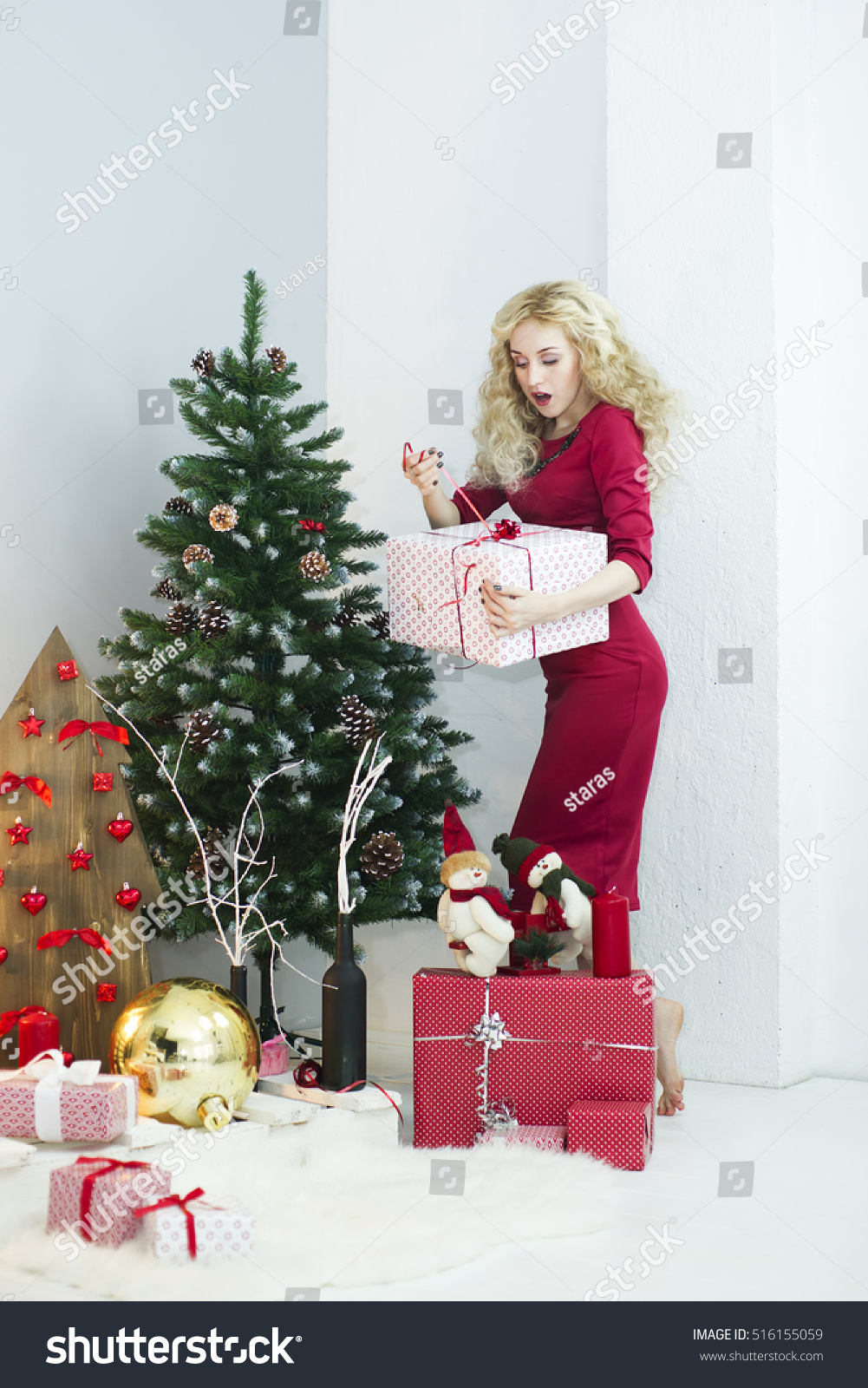 Beautiful woman red dress many gift stock photo