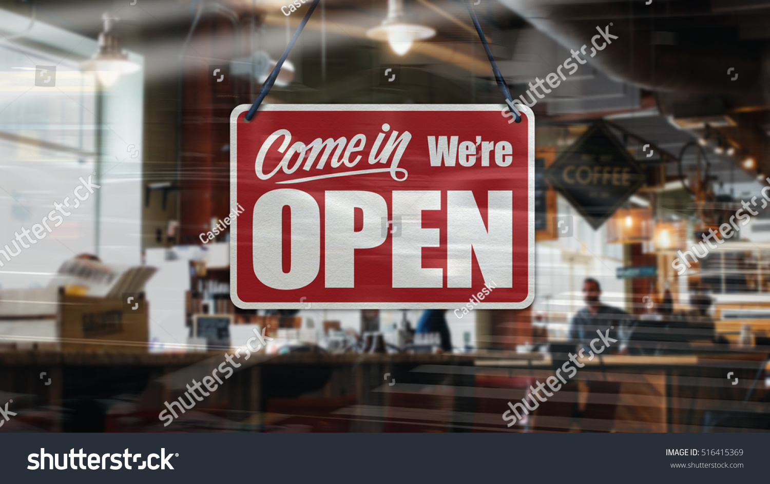 A business sign that says 'Come in We're Open' on Cafe / Restaurant window. #516415369