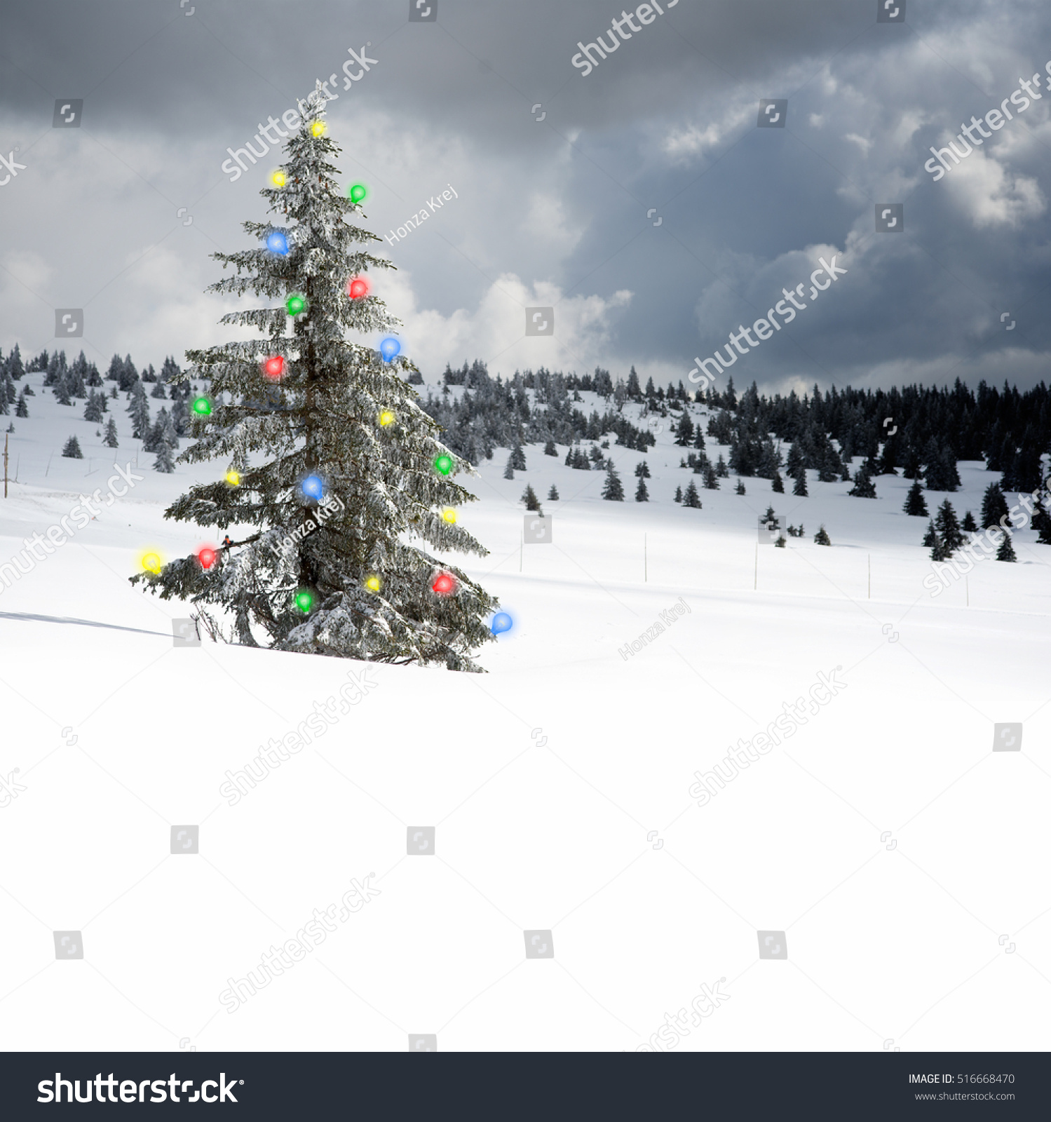 Snow covered christmas tree with small hut christmas winter scene
