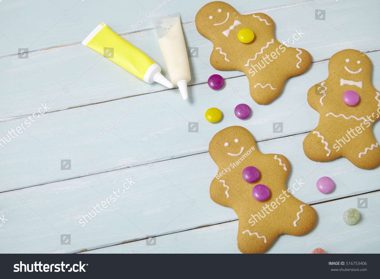 Hand Decorated Gingerbread Men On Painted Stock Photo Edit Now