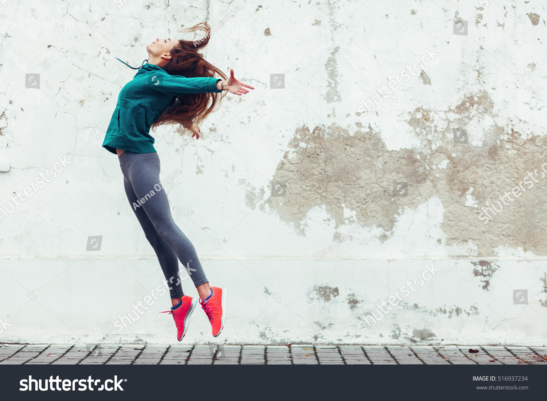 Fitness sport girl in fashion sportswear dancing hip hop in the street, outdoor sports, urban style #516937234