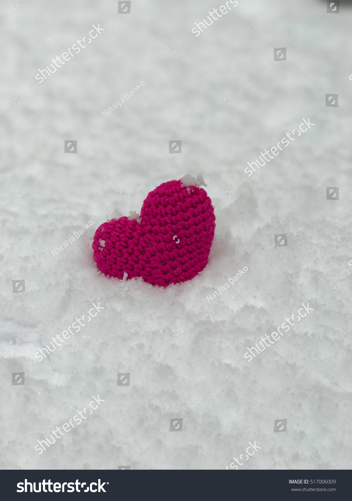 St. Valentine\'s Day heart with free space. Knitted red heart on the ...
