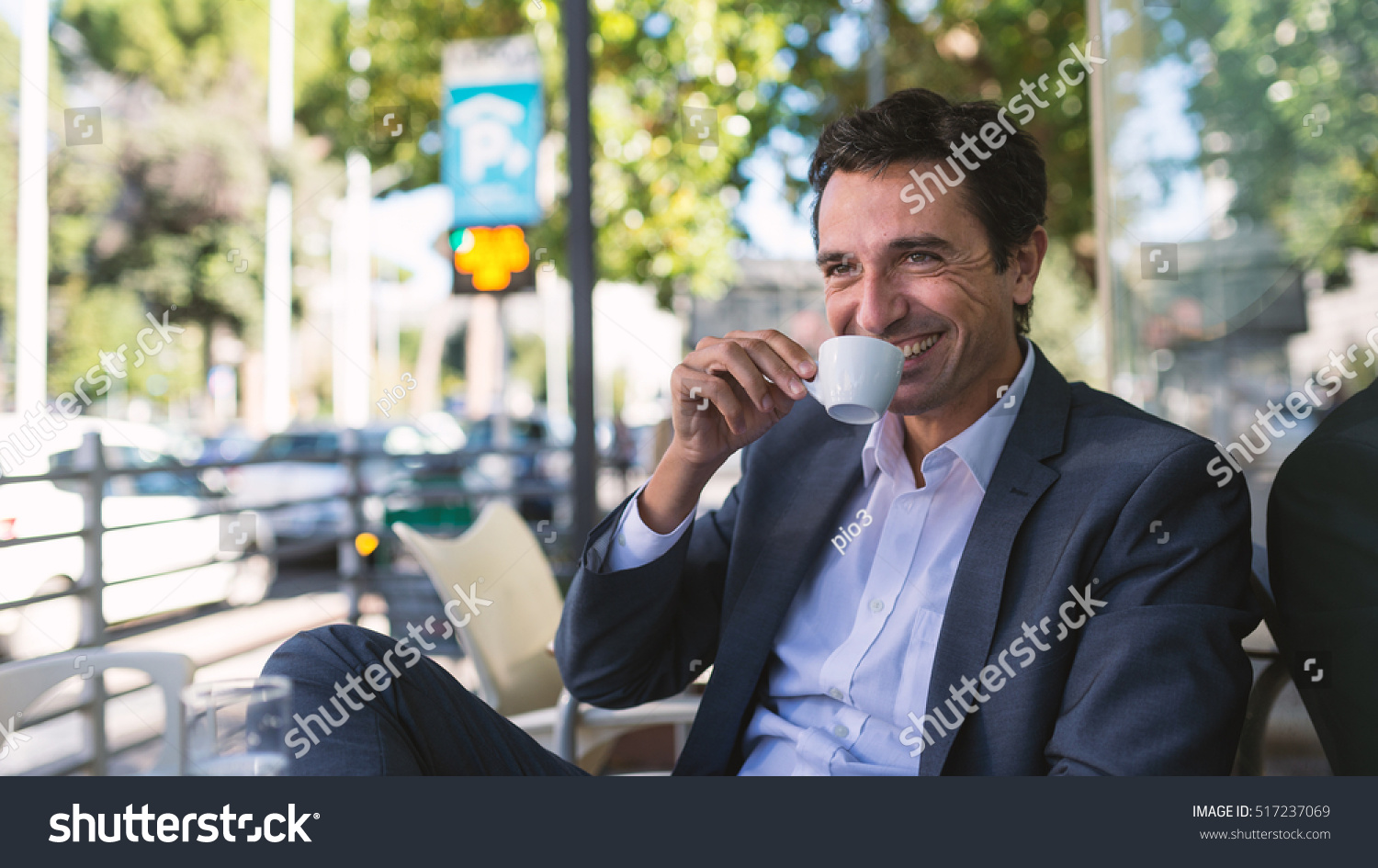 happy middle age businessman portrait drinking stock photo happy middle age businessman portrait drinking a coffee outdoors in rome