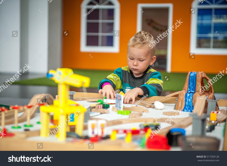 Toys For Boys Kindergarten : Children play wooden toy build stock photo