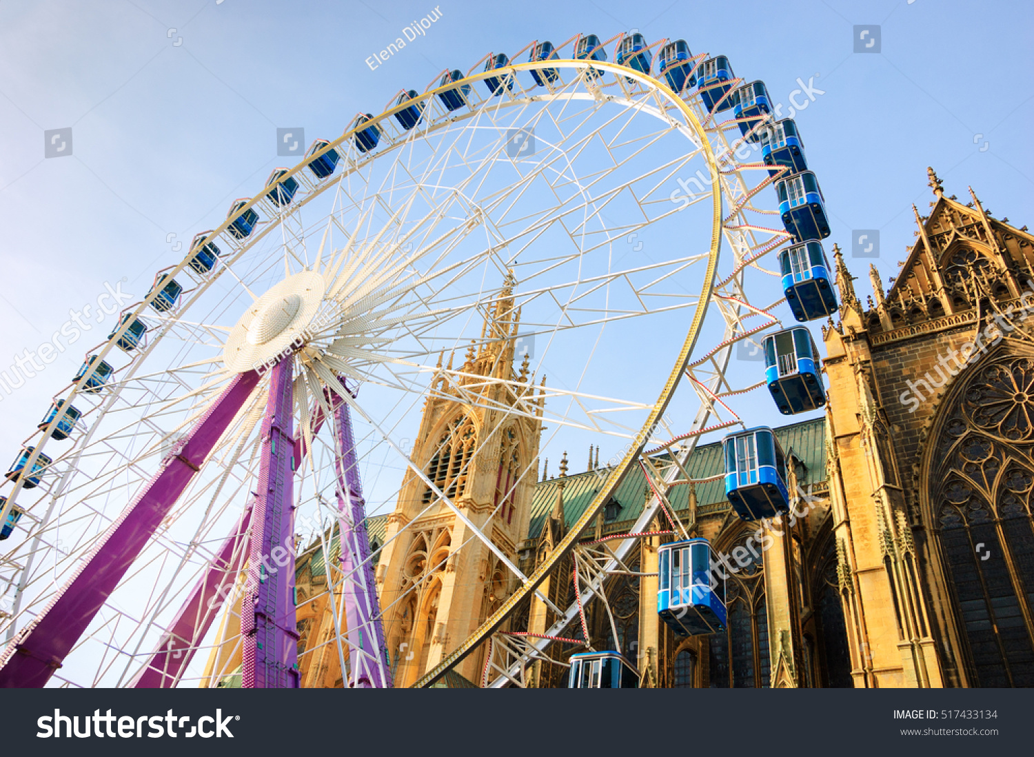 christmas ferris wheel in front of the cathedral of metz metz france