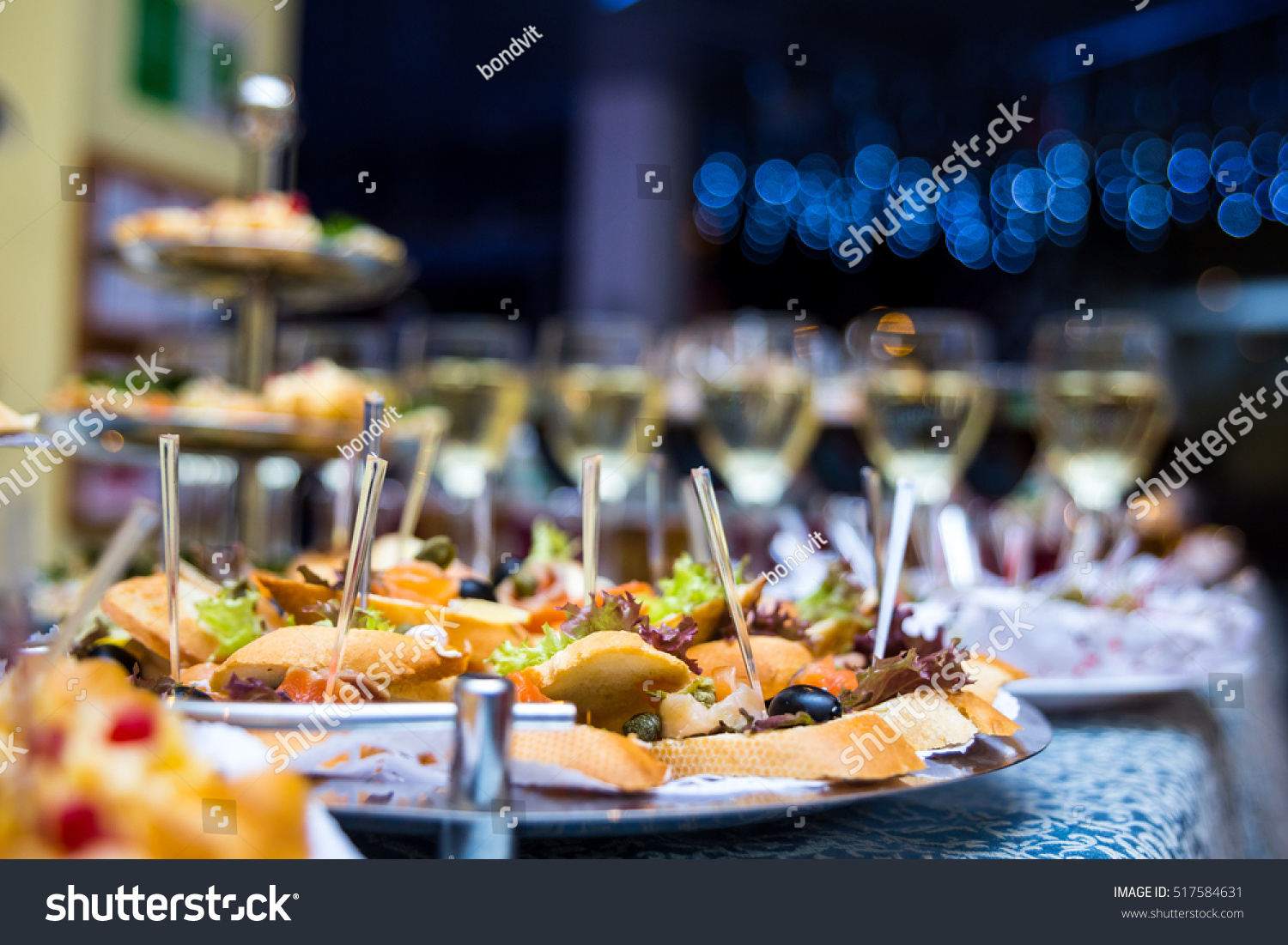 Holiday Buffet Table Served By Different Canape, Sandwiches, Snacks Ready  For Eating In Restaurant