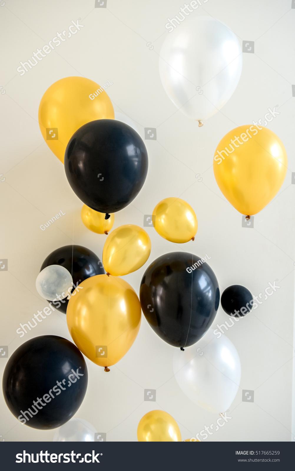 Many Bright Yellow White Black Balloons Stock Photo & Image (Royalty ...