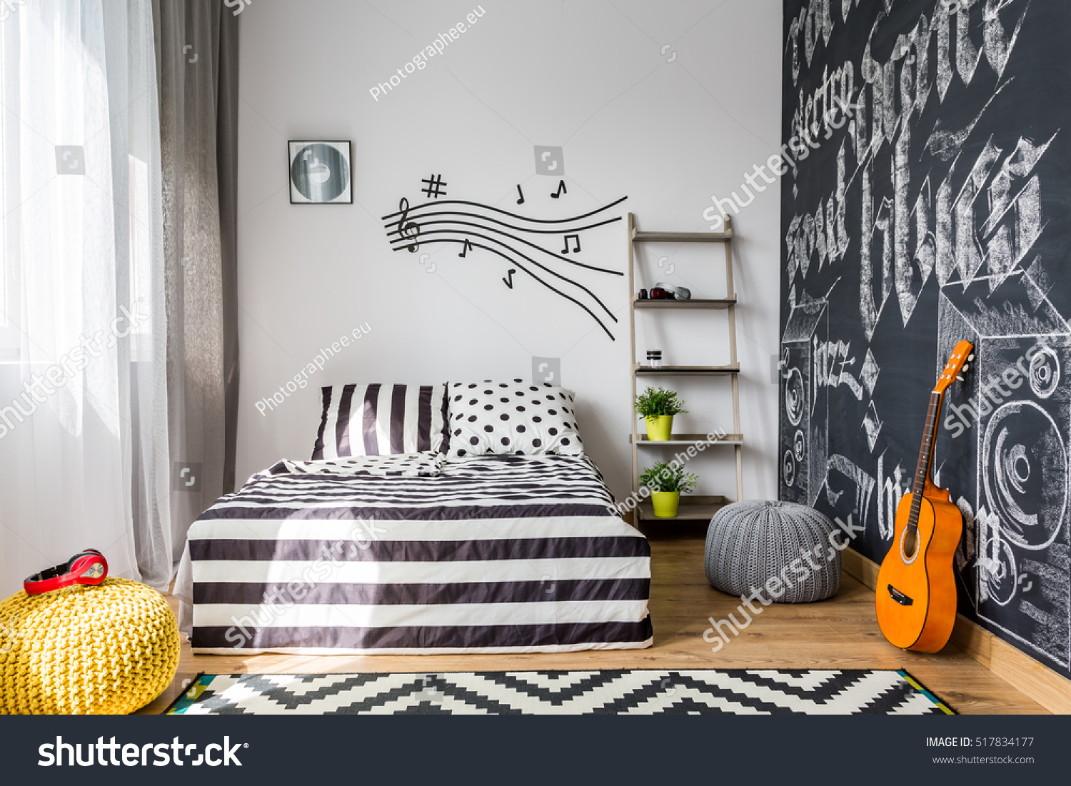 Shot of a cozy music inspired bedroom #517834177