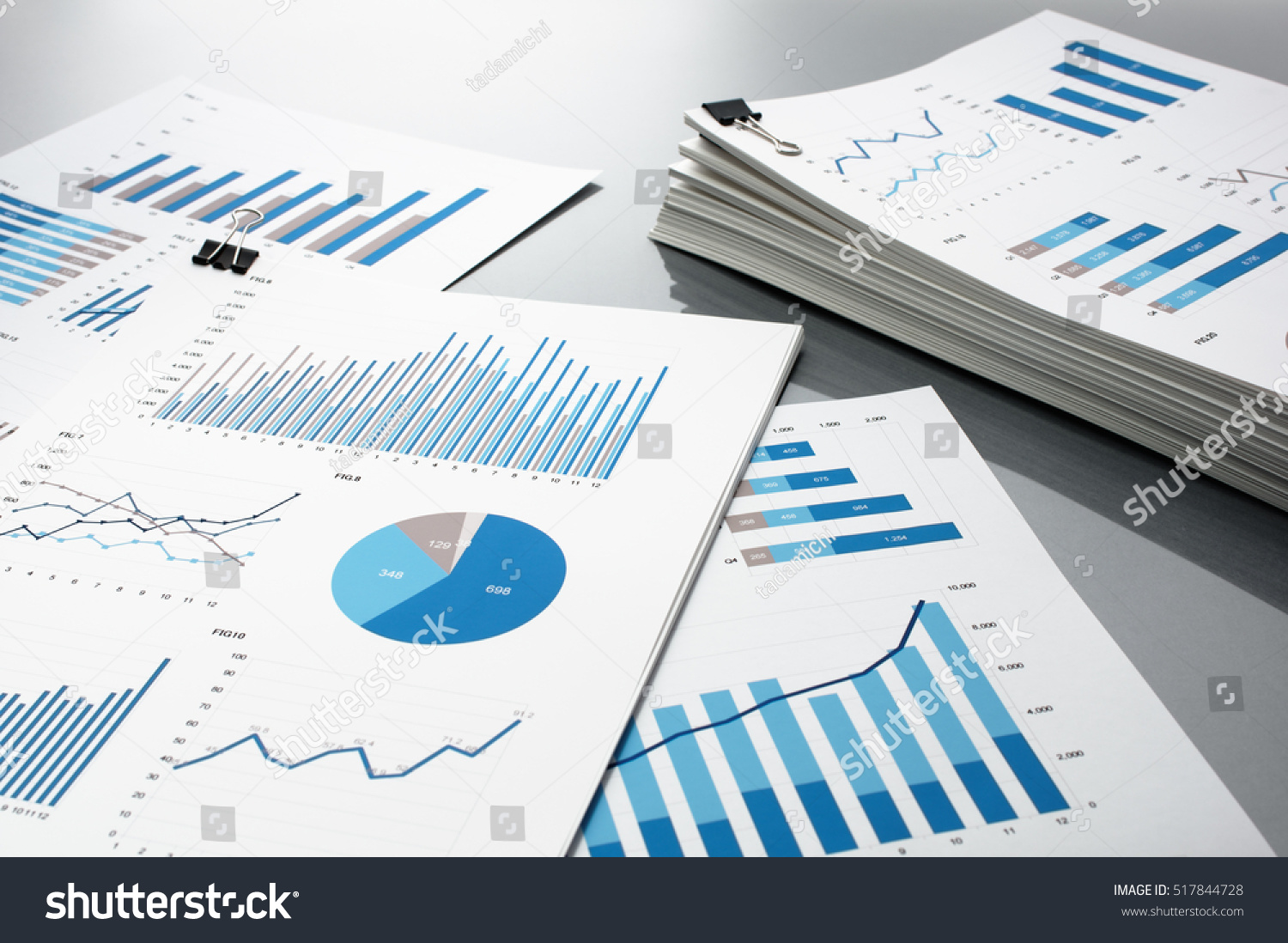 Pile Of Reports : Preparing report blue graphs charts business stock photo