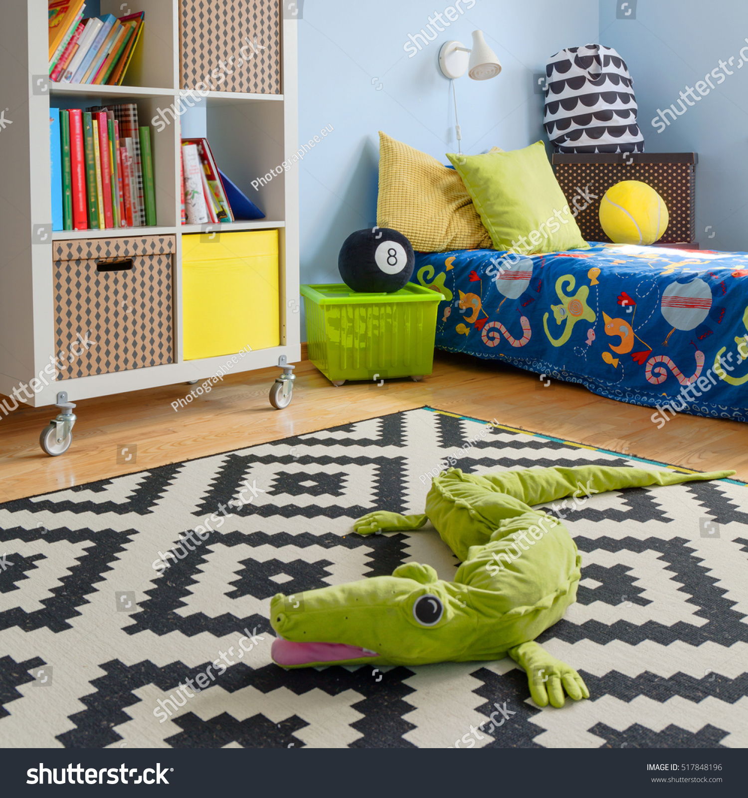 Shot of a modern colorful children's room with crocodile toy on the floor