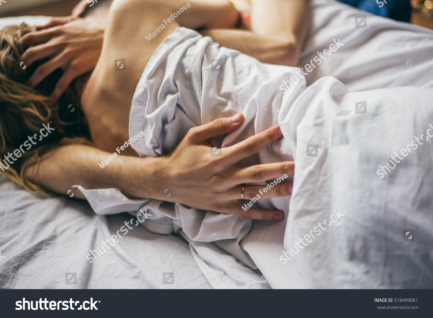 beautiful couple lying together on bed stock photo 518499061 shutterstock. Black Bedroom Furniture Sets. Home Design Ideas
