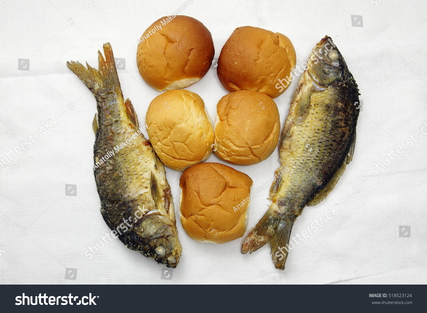 Five loaves two fishes stock photo 518523124 shutterstock for Loaves and fish
