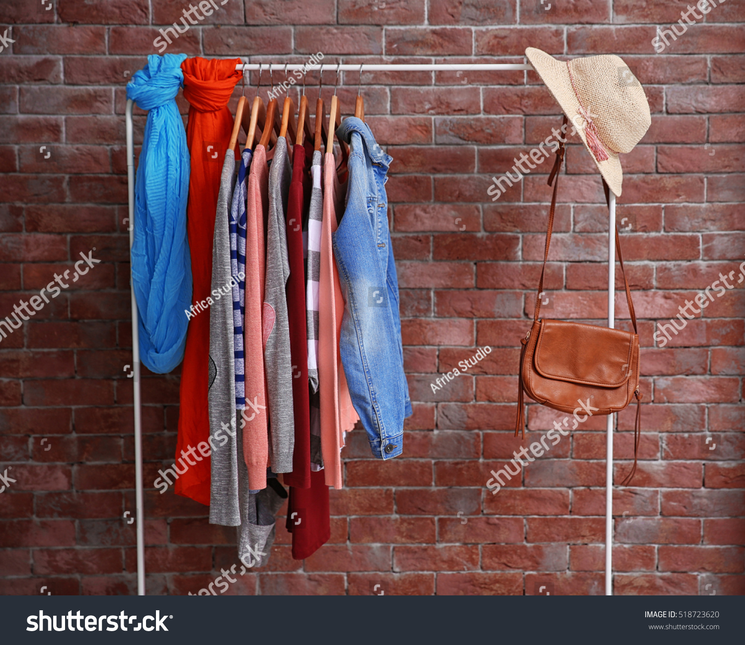Hangers Different Female Clothes On Brick Stock Photo (Edit