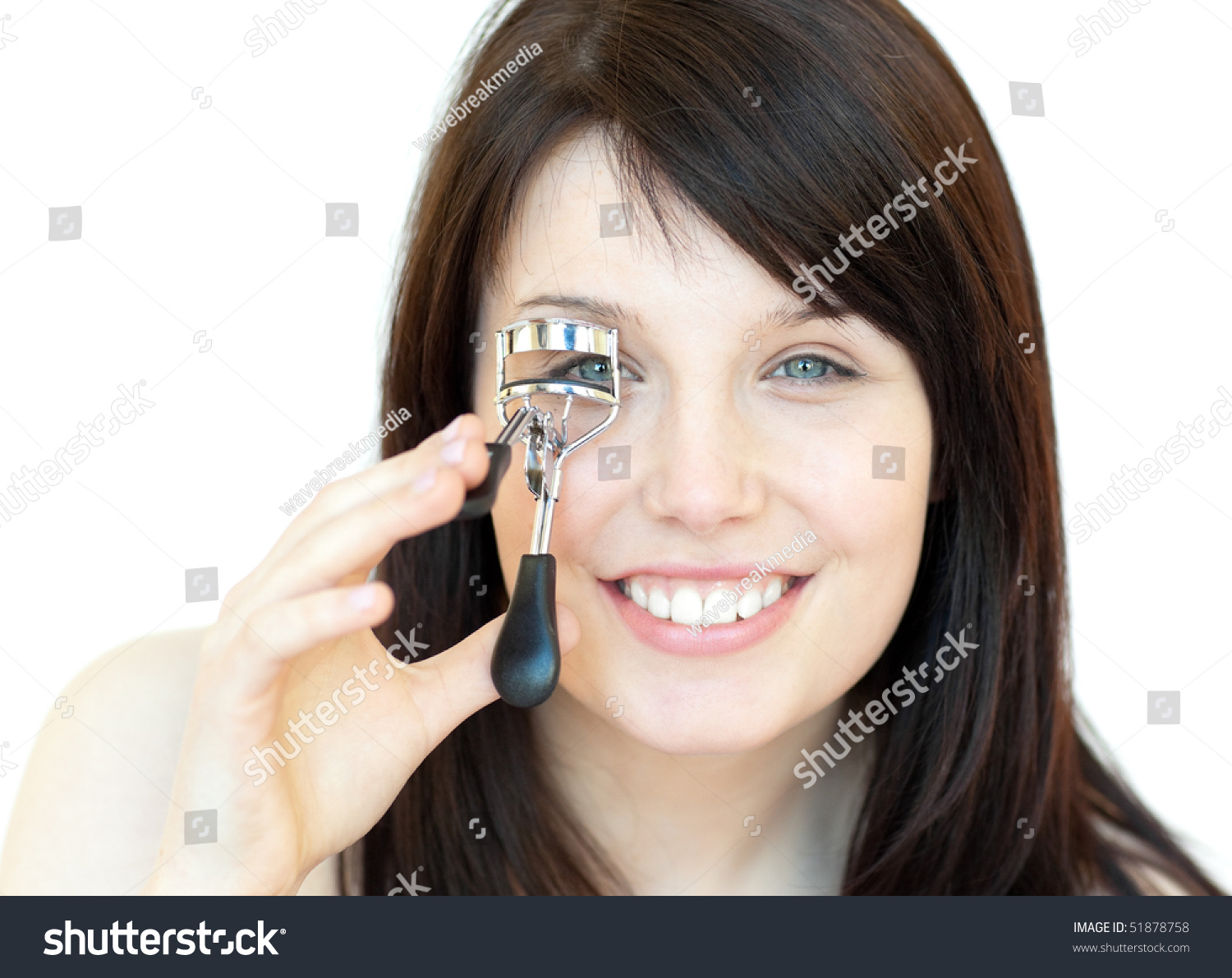 Charming teen girl using an eyelash curler against a white background stock photo 51878758 - Charming teenage girls image ...