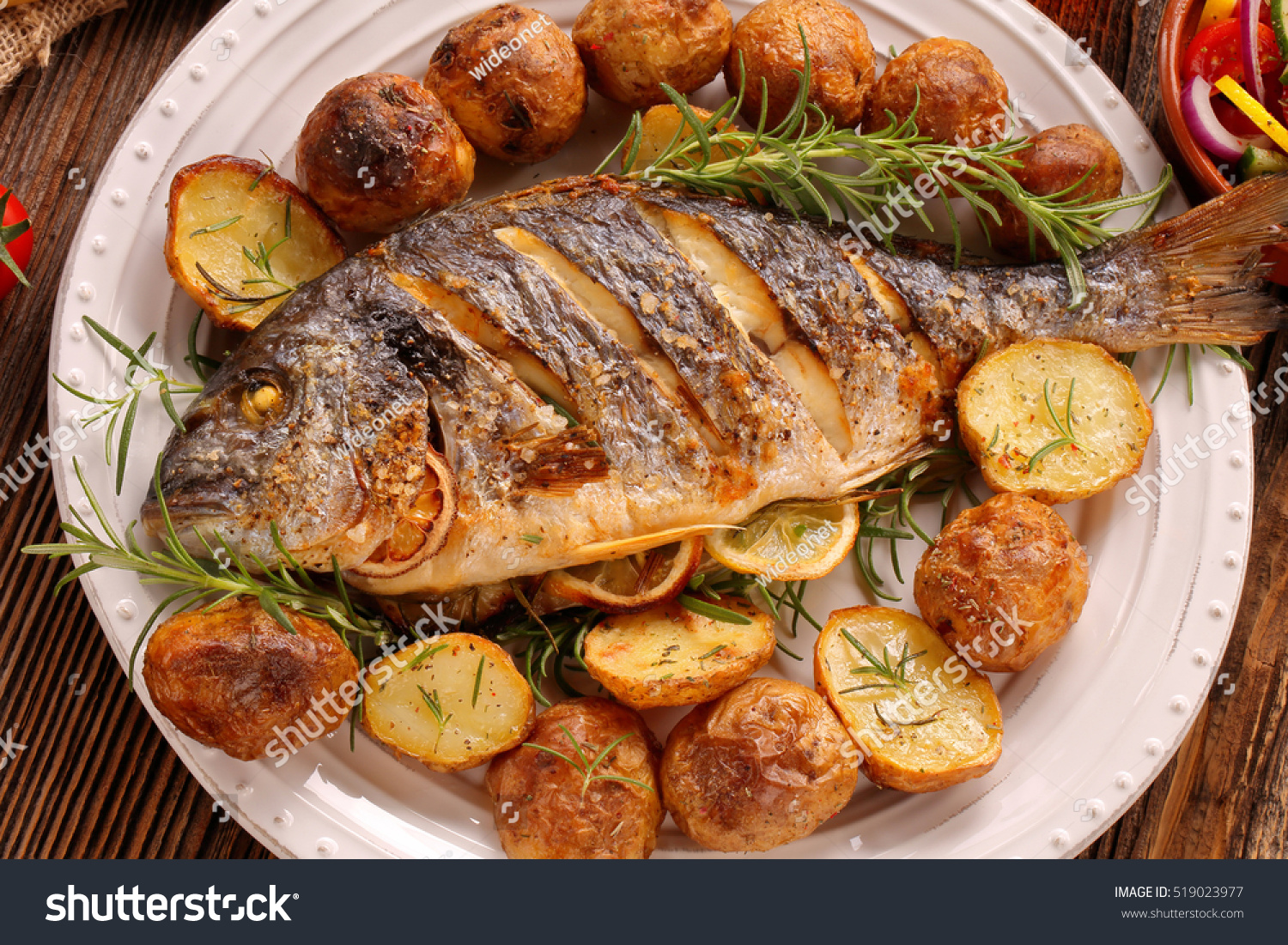 Grilled fish roasted potatoes vegetables on stock photo for How to cook fish on the grill