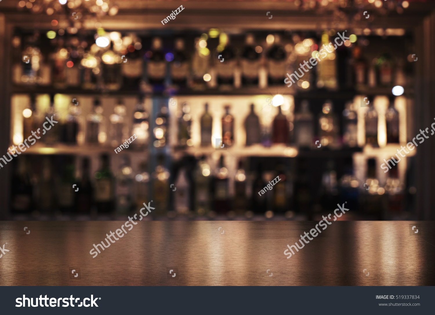 Empty wooden bar counter with defocused background of restaurant, bar or cafeteria and copy space #519337834