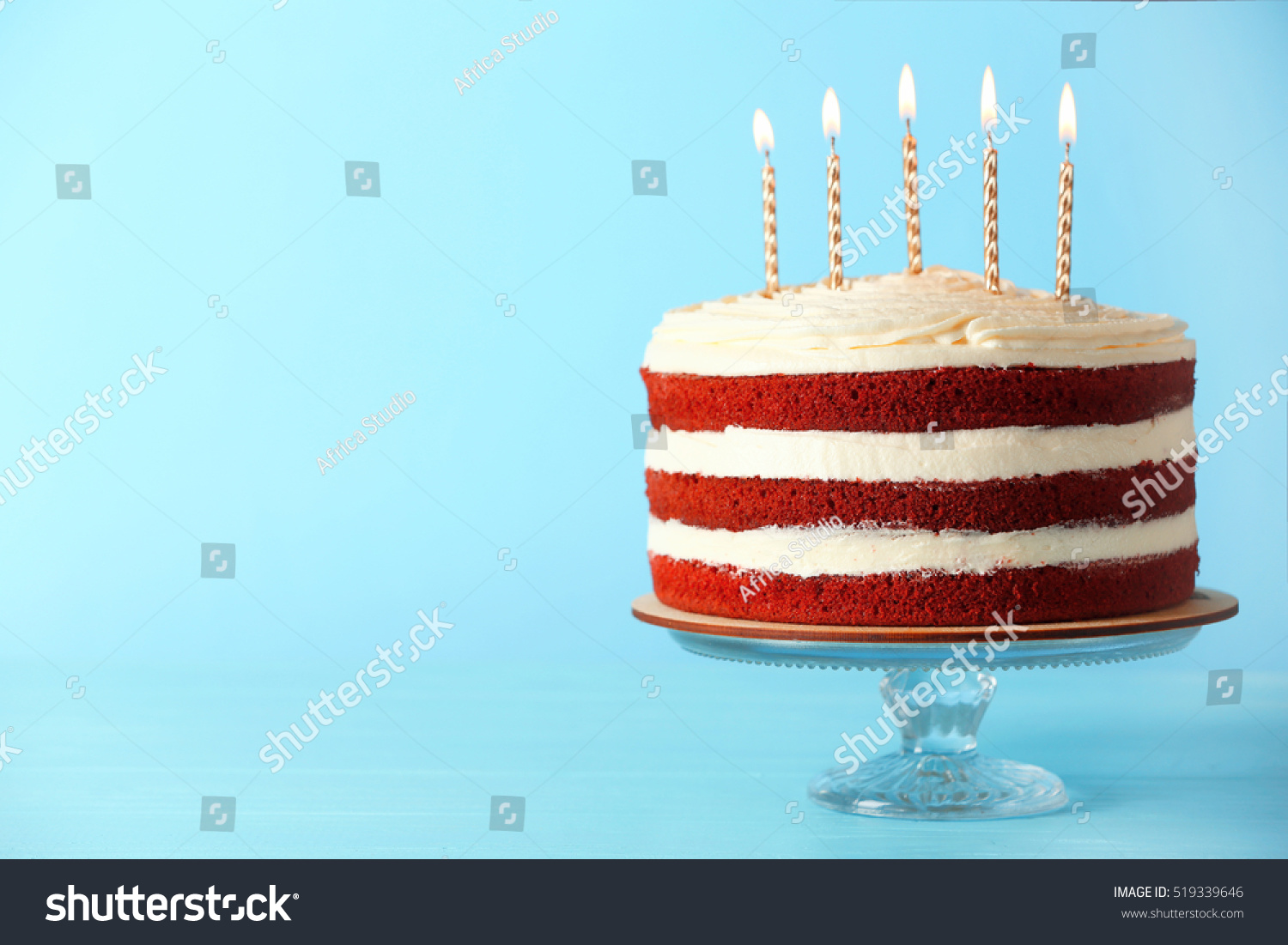 delicious cake candles on blue background stock photo