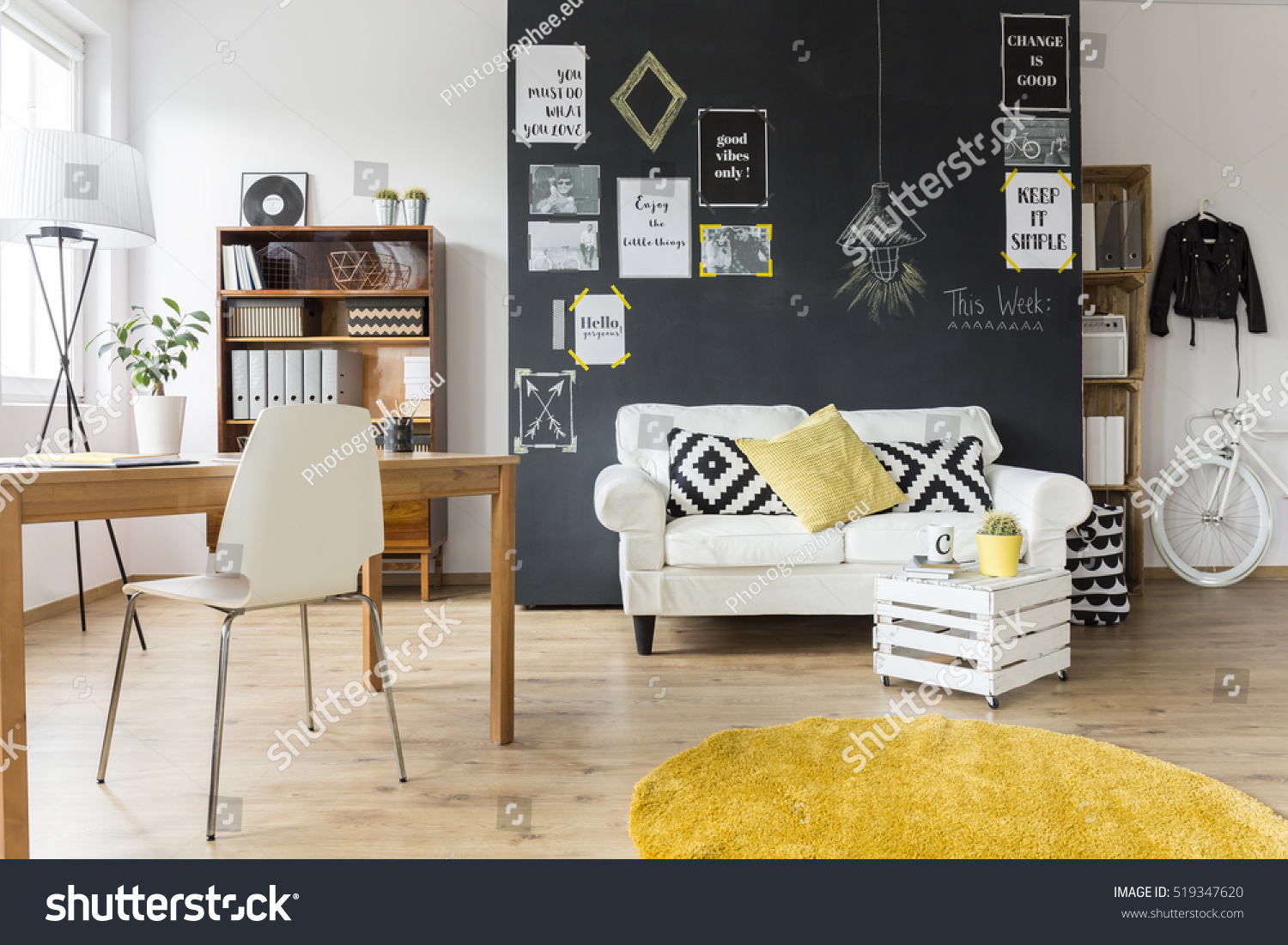 Creative living room with chalkboard wall, wooden desk and vintage furniture