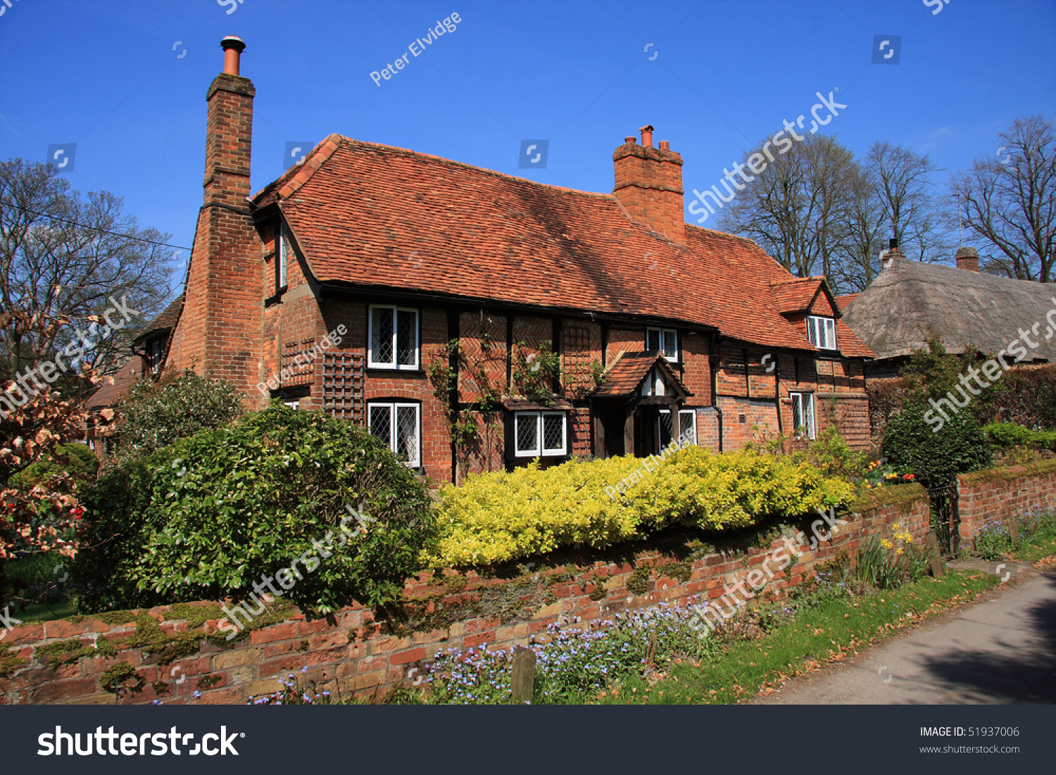 Attractive English medieval brick and timber cottage with garden ...
