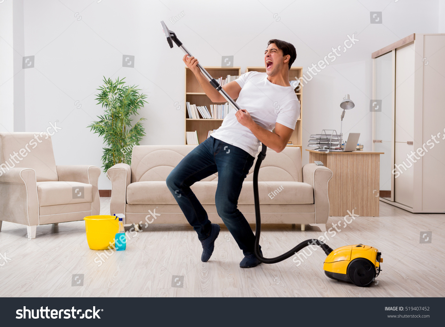 Man cleaning home vacuum cleaner stock photo 519407452 for House cleaning stock photos
